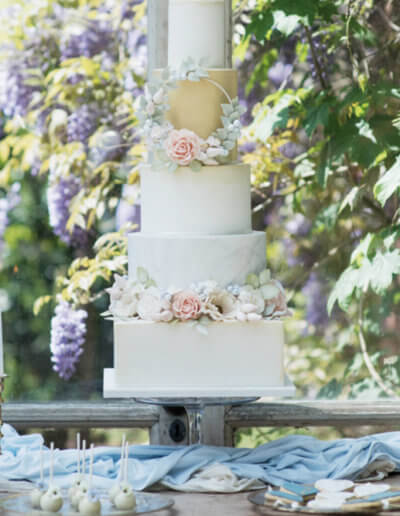 Floral hoop 5 tier wedding cake