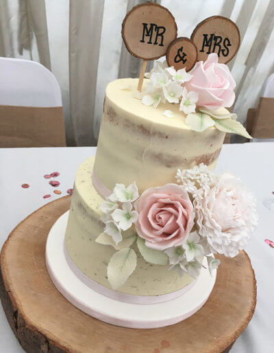 Semi naked cake with roses and peony