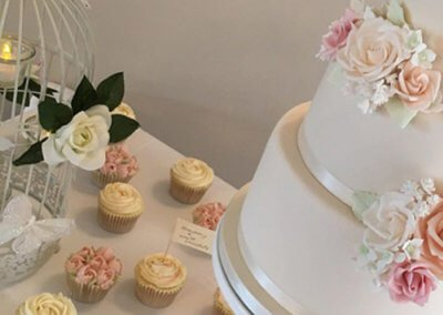 pink blush roses gypsophlia cupcakes wedding cake