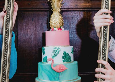 flamingo pineapple palm leaf gold pink green cake