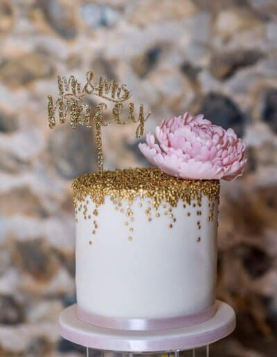 gold confetti cake with blush peony