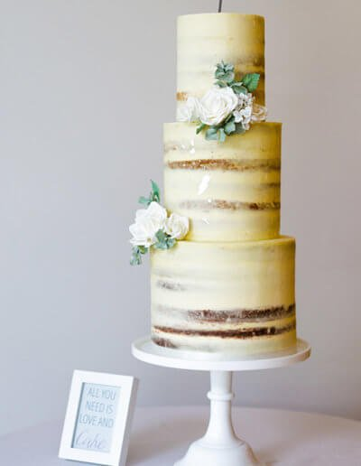 Tall semi naked wedding cake