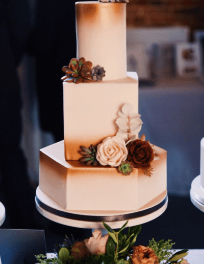 Geometric copper wedding cake with succlents
