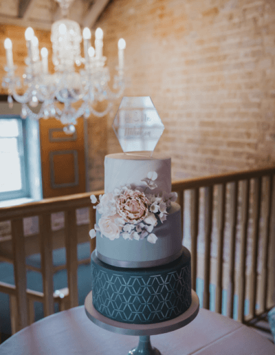 Grey blush geometric hexagon wedding cake