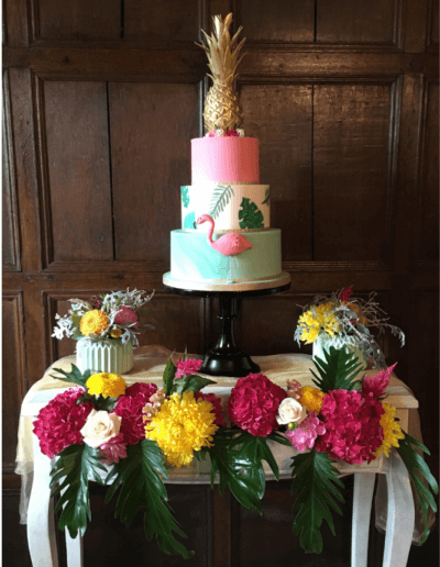 Tropical flamingo pineapple wedding cake