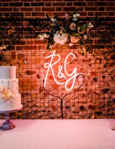 Neon sign wedding cake table