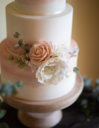 blush rose wedding cake eucalyptus peony
