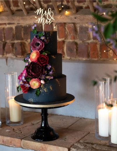 dramatic navy gold wedding cake