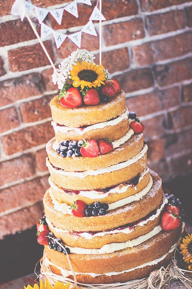 Naked wedding cake with sunflower