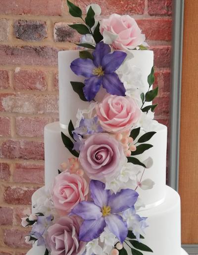 Lilac_pink_flowers_wedding_cake